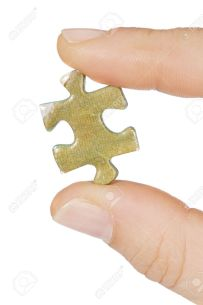 A-piece-of-a-puzzle-a-over-white-background-Stock-Photo